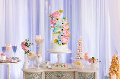 """Elegant and whimsical wedding cake in white with sugar flowers and lovely sweets.  A Stunning """"Blooming Romance"""" Styled Shoot"""