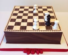 Chess cake with a puzzle: Checkmate by White in two moves.  Caramelized apples and Bavarian mousse.  Modeling chocolate decorations.