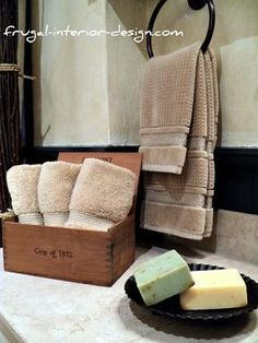 Wooden cigar boxes can display wash clothes and hand-soaps with style.