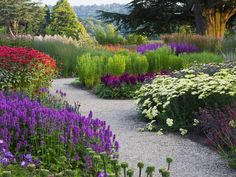 Love this colorful flowering plants and the #stone #garden #path. Check more at www.wisconsinrealestate.com