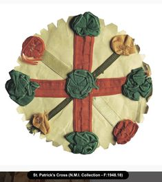 A St Patrick's cross, a circular badge made of cloth featuring a cross decorated with rosettes; St Patrick's crosses were traditionally worn by children in Ireland on St Patrick's Day, 17 March. (National Museum of Ireland)