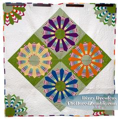 Dizzy Dresdens: A FINISH! What a colorful and cheery quilt. The quilter should be proud.  Peace, Robert from nancysfabrics.com