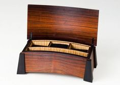 Box made from Rosewood, Ebony and Fiddleback Maple. Lined with Pig Skin Suede.