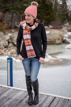 Winter Fashion: Pink Plaid in Maine This outfit is a great example of how a basic black sweater, blue jeans, and black boots can look cute and put together with a few well-chosen accessories.