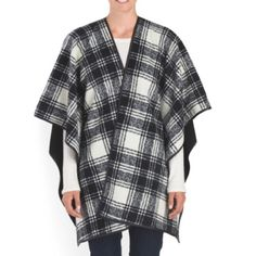 Black and White Plaid Fleece Blanket Style Cape OS Black and white plaid blanket style cape. Poncho sleeves,   Open neck, medium weight poly blend fleece.  Eivissa. machine wash. One size fits most. Jackets & Coats Capes