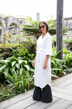 Wrap an Oversize Button-Down Over Your Flared Pants to Play With Shapes