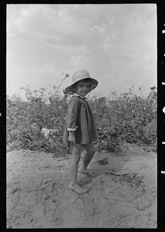 1938 Child of farmer in cotton field at Lake Dick Project, Arkansas