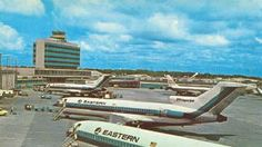 Hartsfield Atlanta International Airport  Eastern Airlines Boeing 727s parked at Concourse B. Note the Piedmont Airlines Boeing 737 at Concourse C.