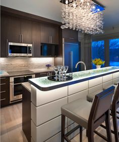 modern kitchen : light fixture : cabinets : illuminated counter top detail