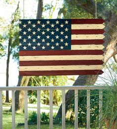 Wooden Americana Flag-Inspired Accent:: i'm not proud of my country today, but the way this flag was made to look older kinda makes me think of its ideals, so i would consider getting this. :]
