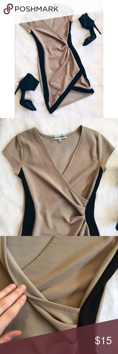 """Almost Famous Tan Angled Wrap Short Sleeve Dress ▪️Product Description▪️ ▫️Sexy and fitted with an angled wrap style skirt and torso  ▫️Fits like a glove: 95% Poly, 5% Spandex ▫️Black panels on the side and trim along the bottom  ▫️Pair with black stilettos for a night out  ▫️Fabric gathers towards the waist  ▪️Fit: True small, hourglass shape, long on sides with the shortest part in the center  ▪️Condition: Excellent  ▪️Measurements: Approx/Laying Flat  ▫️Length: 33"""" (29"""" at slit)  ▫️Bust…"""
