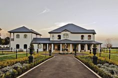 This equestrian property in KwaZulu-Natal is the realisation of the owners' dream for a modern farmhouse featuring high ceilings, large windows and lots of natural lighting. Farmhouse Architecture, Modern Architecture, Kwazulu Natal, Large Windows, Modern Farmhouse, In This Moment, Mansions, Lighting, House Styles