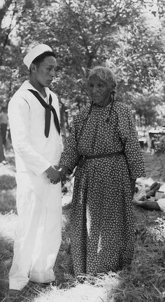 Seaman David Crazy Thunder (Oglala) and mother, Pine Ridge Indian Reservation, South Dakota, 1945. Native American WWII