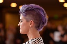 Kelly Osbourne, long known for rocking purple hair, has gone a step further and shaved her head into a purple Mohawk! Description from fashionnstyle.com. I searched for this on bing.com/images