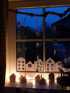 Houses, buildings, stars in the window. Some mini lights; great display in the Winter months.