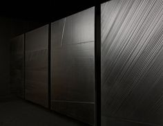 Abstract minimalist artist Pierre Soulages (1919) is also called the painter of black. He sees light as a matter to work with. Striating the black surface of his paintings enables him to make the light reflect, and allows the black to come out from darkness and into brightness. Black becomes a luminous colour.