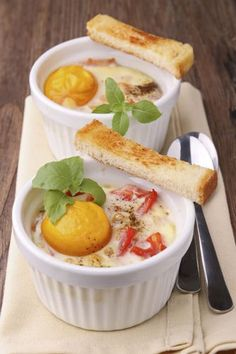 In North Africa, eggs are often baked on top of vegetable stews. This protein rich Chickpea, Tomato & Egg Bake is an extension of this tradition. Tomato Egg Bake, Vegetable Stew, Inexpensive Meals, Egg Dish, Most Popular Recipes, Baked Eggs, Mets, Daily Meals, Calories