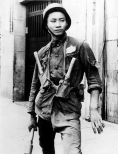 Chinese soldier holding a grenade in Shanghai, September 1937.
