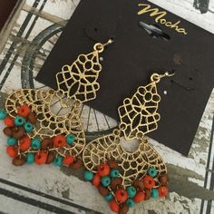 "NWT! Dangle earrings NWT! Beautiful & intricate dangle earrings! 2"" in length Mocha Jewelry Earrings"