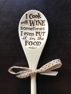 Wood Burned Spoon hand lettered with the quote I Cook with Wine, sometimes I even put it in the Food Bow included. 12 wooden spoon. Intended for decorative use but can be used for cooking.