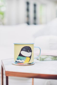 Bring a touch of the great outdoors to your kitchen with bird artist Matt Sewell's enamel mugs. Explore gifts for book lovers at Penguin Shop.