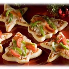Think outside the box with those cookie cutters! Make cookie shaped pizza dough and you have a perfect appetizer/main dish for your Christmas decorating party!