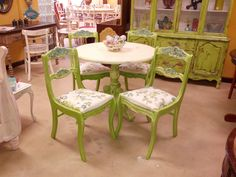 French Country dining set.  These chairs are from the Tell Chair Company and are very old.  I painted them with CeCe Caldwell's Chalk and Clay paint in Spring Hill Green to go with the China Hutch in the background.