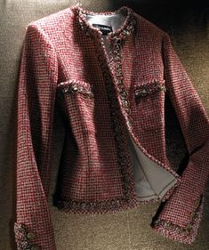 The Iconic Chanel Jacket. - embellished with a crocheted fabric braid.