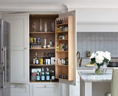 These are the best examples of kitchen s featuring pantry (s) in the cabinet (s). They're SO well done! | Design -er: Brayer Design