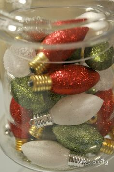 From previous Pinner:  These bulbs always remind me of Charlie Brown. Love them! mod podge + glitter + old burnt out bulbs = pretty (I would put in a pretty glass bowl as a centerpiece)