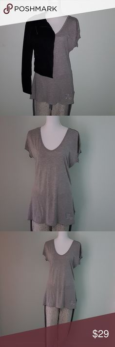 Burberry Brit long gray t-shirt Softest cotton ever. Subdued grey color.  Perfect for lounging around or a quick errand. Please note that there are 3 tiny holes on it. They are about a size of a pin and not really noticeable.  Priced accordingly.  8124 Burberry Tops Tees - Short Sleeve