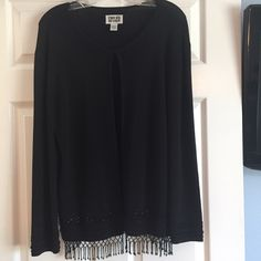 EUC Chico's black beaded fringe sweater Gorgeous for the holidays!! A black sweater with black beading and fringe on the bottom. It has a hook and eye closure on the neckline. Chico's size 2. It is 63% rayon and 37% nylon. Machine wash cold on gentle cycle or dry clean. Chico's Sweaters Cardigans
