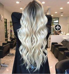 Blonde long hair dark root curly hair