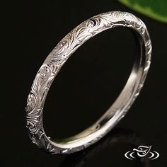 14kt white gold 2mm comfort fit with  scroll engraving This would make a gorgeous wedding band. :)