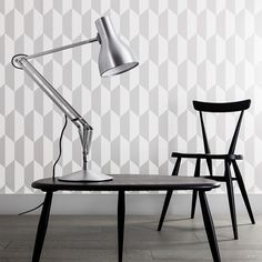 Type75™ table light - Designed by Sir Kenneth Grange. Launched in 2004 as a redesign of a 1970's Anglepoise®, classic looks, smooth lines, flowing movement and full adjustability have made the Type75™ a firm favourite with architects, designers and home-makers alike.Thanks to Ercol and Cole & Son® Tile wallpaper, Photographer: www.spacialimages.com, Stylist: www.emmahooton.com, www.anglepoise.com  TAPETE Frontier Tile, Cole & Son