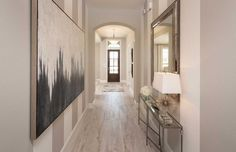 What a grand entrance! We love how the light floors, vertical stripes and subtle decor work together to emphasize the scale of this beautiful space. Cinco Ranch 70s // Katy, TX // Highland Homes // Plan 262