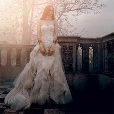 Brides.com: Vampire-inspired Wedding Dresses. This timeless ivory strapless organza gown with draped tulle bodice and swirling tissue organza skirt will take his breath away, $6,990, by Vera Wang. Neck ruffle, $650, by Anne Fontaine, 212-421-0947. Gold vermeil cuffs, $195 each, by Alexis Bittar. Oxidized sterling silver and ruby rings, $1,650 and $1,540 each, both Byzantia by Stella Flame, available at Shirise, Glencoe, IL, 866-744-7473. Gold, silver and ruby ring, $1,000, by Nava Zahavi…