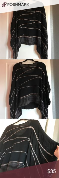 Black & Beige Netted Back Loose Tunic Top Never worn! Beautiful top to wear with jeans and leggings it's not tight has a lot of nice movement to it and is really comfortable and soft. The back has a netted material that gives it a little bit of a different look then all other tops I have seen similar to this. I added a picture of my hand under the back part so you can see it's not see through whatsoever. The top itself is 100% Rayon, with Spandex and Cotton…