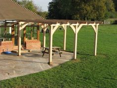 Oak pergola, milled and made on site for a Surrey farmhouse