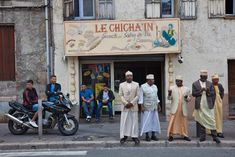 Marseille by Ed Kashi  After Friday prayers Comoran men in traditional robes and caps wait for friends alongside—but definitely apart from—fellow Muslims from the Maghreb.