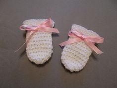 Cute little crochet baby mittens.