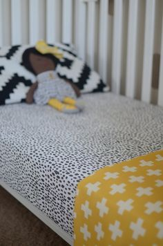 Love the mix of patterns and the black, white, and yellow on this bed