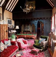 The former schoolroom soars 30' and is lit by a pair of Pugin chandeliers. Left intact is the carved wooden partition that separated students from the schoolmistresses' quarters. The furniture is a comfortable mix.