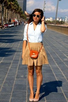 Preppy: Classic white button down shirt with a line skirt