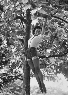 On this day in 1927, singer Eartha Kitt was born. Here's a great shot from the archive of Eartha swinging in a tree by Gordon Parks.