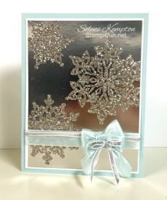 handmade winter/Christmas crd from Create with Selene ... Festive Flurry snowflakes emboss glittered on silver foil .. stunning! ... luv the delicate bow of sheer seam binding in icy blue ... Stampin' Up!