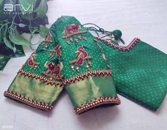 Stunning green color designer blouse with dancing peacock design hand embroidery trhead and bead work. Blouse Back Neck Designs, Hand Work Blouse Design, Simple Blouse Designs, Stylish Blouse Design, Aari Work Blouse, Wedding Saree Blouse Designs, Pattu Saree Blouse Designs, Blouse Designs Silk, Wedding Blouses