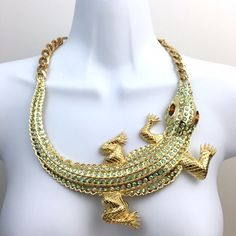 """Cocodrile necklace Such an amazing statement. You will say why have a golden cocodrile around my neck? Well, because you can! This one is a fun piece. More pics coming soon. Length is 20"""". Alloy metal and resin with rhinestones. Chocker style. Boutique Jewelry Necklaces"""
