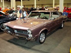 Possibly the one to start the American muscle car craze, the Goat or 1965 Pontiac Tempest GTO option featured racing car options that remained inspirational long after it was out driven in speed and power. From 0-60 in 6.1 seconds was not shabby, but not awe-inspiring considering the next 10 years of muscle cars. Regardless, this muscle car has the chops to make this list just by starting the phenom that has turned car enthusiasts into weekend warriors under the hood.