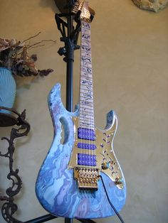 Love the Blue Swirl, the lavender pick up covers, the mirrored pickguard, and the neck design.  I love it all and want it all....is that so wrong?